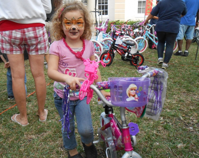 The first winner of the girls bikes.