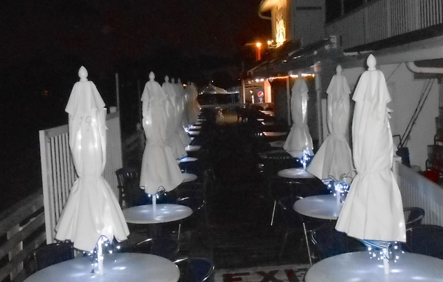 New  white umbrellas lit for evening dining.