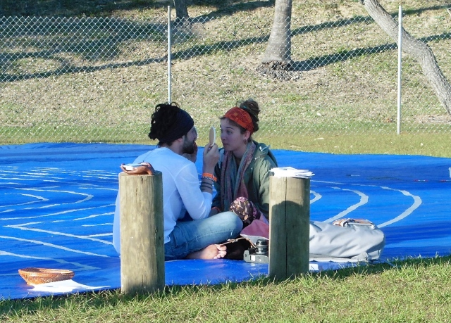 two on a portable labyerint or meditation circle