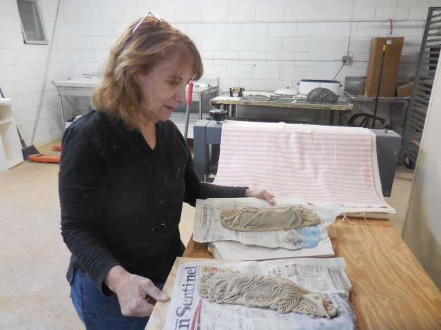 This is Joyce Greenberg Brown working on a very special commission for a temple Mazol Tov