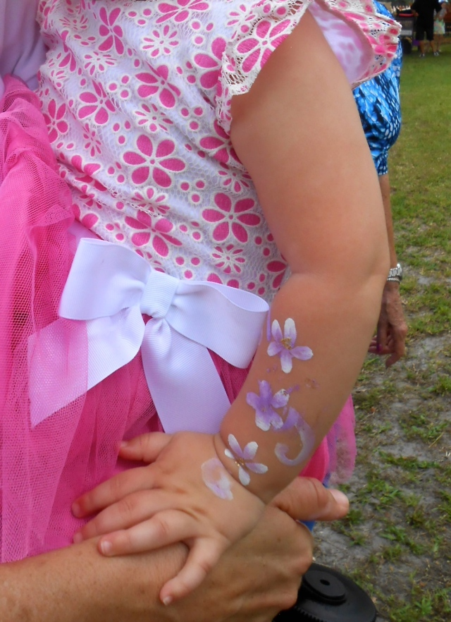 she loved her arm painted delicately to match her outfit.